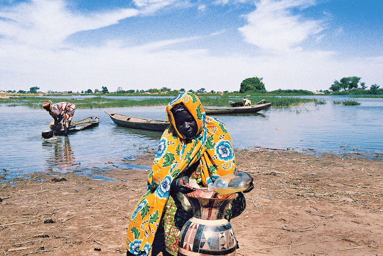 In the Liptako-Gourma region, Niger, an area that has experienced large-scale land degradation and water scarcity, a villager takes extra precautions to keep her supply of water clean. Credit: UNDP/Rabo Yahaya