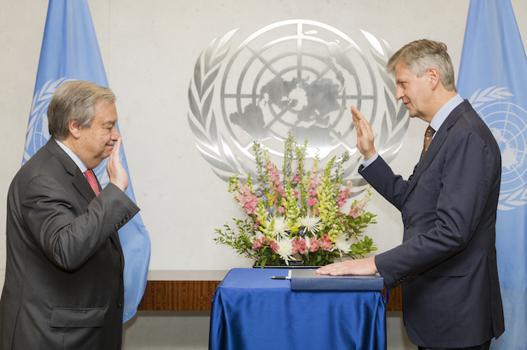 UN Secretary-General António Guterres (left) swears in Jean-Pierre Lacroix, Under-Secretary-General for Peacekeeping Operations. 12 April 2017. United Nations, New York. Credit: UN Photo/Rick Bajornas.