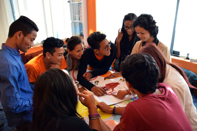 Photo: Youths of Rocket and Space group in Kathmandu brainstorm on how to make their presentations on Sexual and Reproductive Rights more effective. Credit: Stella Paul | IDN-INPS
