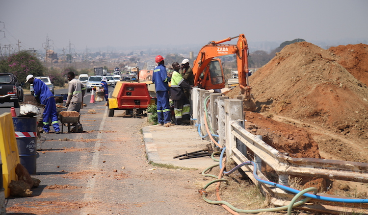 Photo: As infrastructural boom spreads across Southern Africa, in Zimbabwe, workmen are busy on highways giving an upgrade to the country's major roads. Credit: Jeffrey Moyo | IDN-INPS