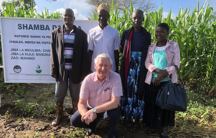 Photo: Norwegian entrepreneur and project manager Osmund Ueland posing with some farmers at Masukanzi village in Iringa Tanzania. Credit: Kizito Makoye