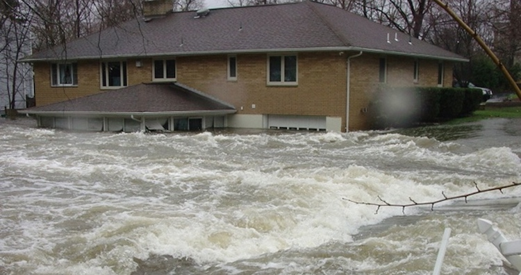 Photo: Flood waters rush around a house in Long Island, New York. Credit: U.S. Geological Survey