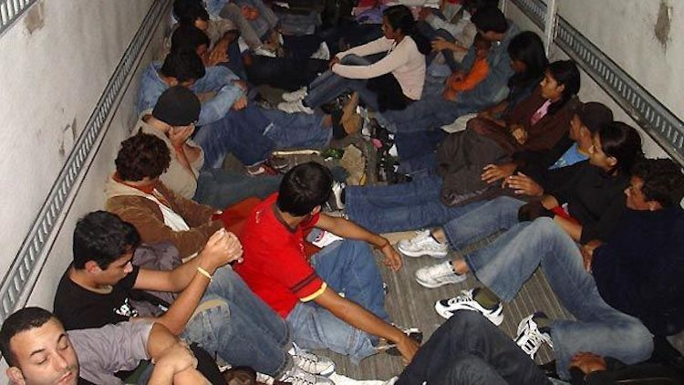Photo: Transporting new migrant workers to Doha, Qatar. Source: tellmemoreblogger.com