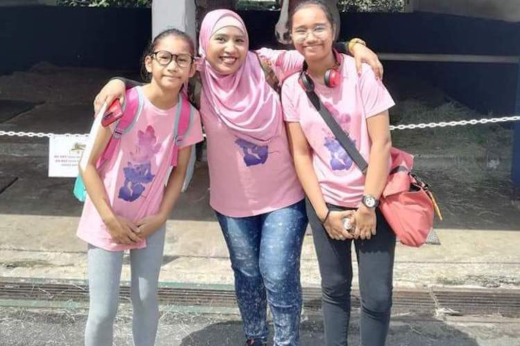 Photo: Rosilah Abdul Hamid (centre) with her 13 year old daughter Syafeeqah Mohd Rusdi (on the right) and 10-year old Nureen Irdeenah Mohd Rusdi (on the left). Credit: Kalinga Seneviratne | IDN-INPS